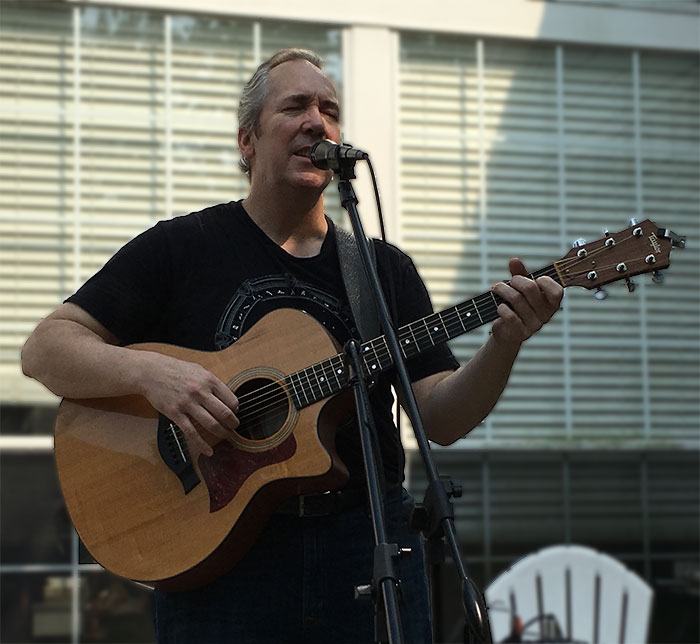 Picture of Ken Theriot Singing With Guitar and Mic